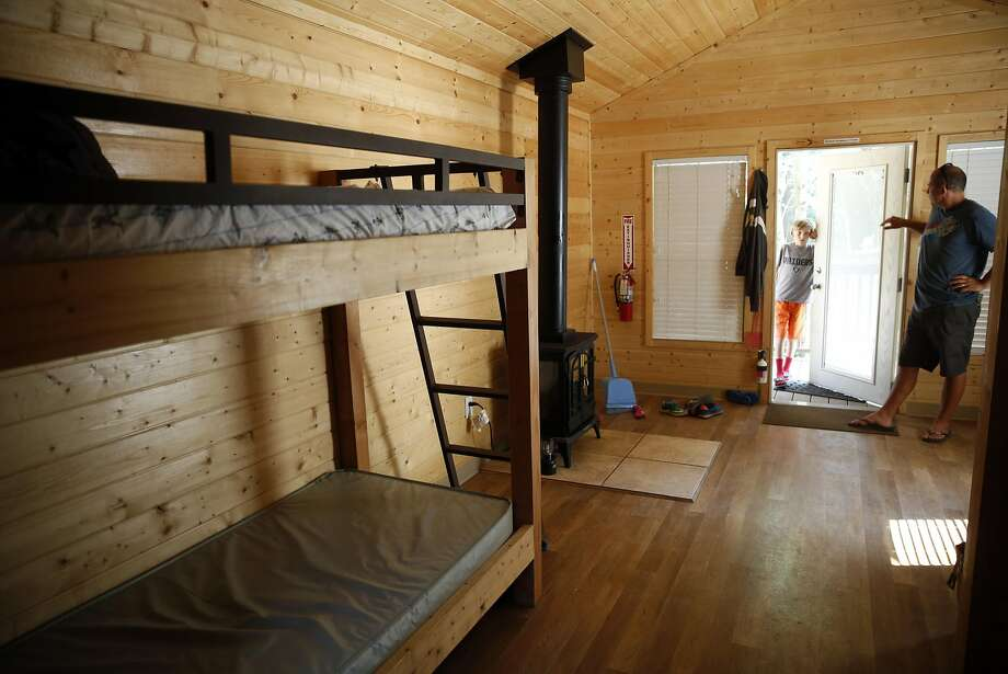 Joe Petersen of Berkeley and son Isaac inside their rented cabin in Samuel P. Taylor State Park. Photo: Scott Strazzante, The Chronicle