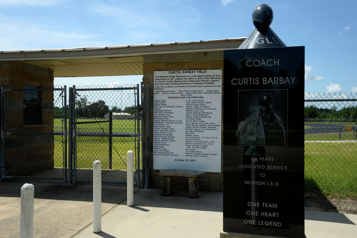 A monument to the late Coach Curtis Barbay outside of Newton's Singletary Stadium. The stadium's field is named for the longtime coach. Photo taken Wednesday 8/3/16 Ryan Pelham/The Enterprise