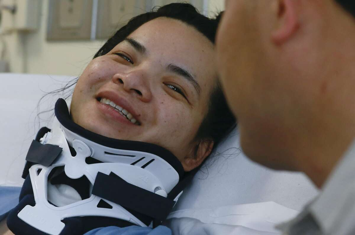 Emma Zhou smiles at her husband Tony Tan at Laguna Honda Hospital in San Francisco, California on Thurs. August 25, 2016, where she is recovering after a tree branch fell onto her at Washington Square Park, leaving her paralyzed from the waist down.