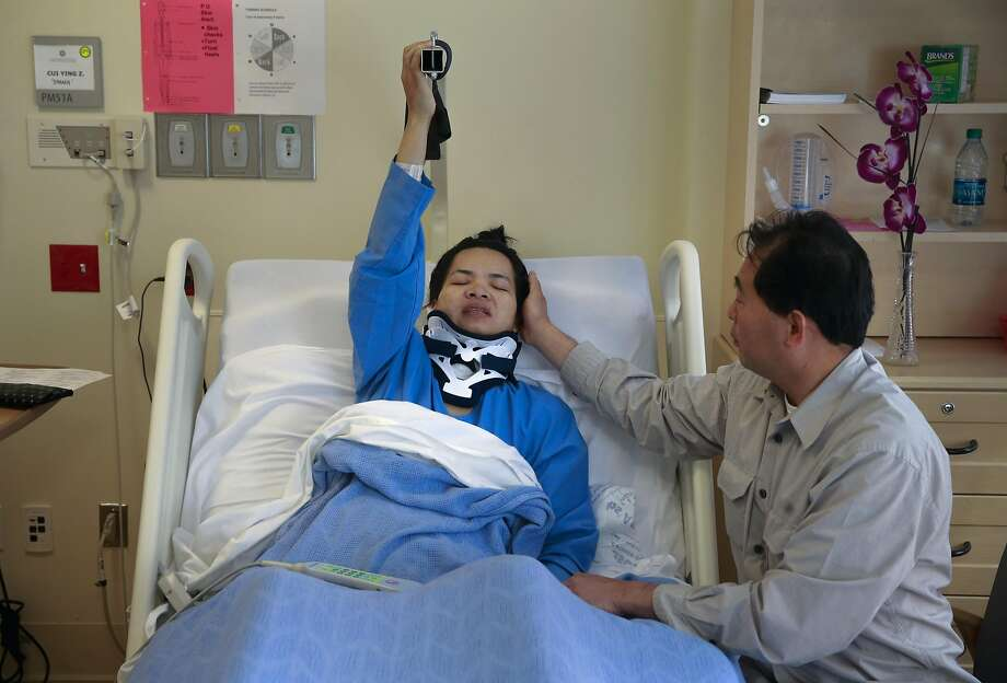 Emma Zhou with her husband Tony Tan at Laguna Honda Hospital in San Francisco, California on Thurs. August 25, 2016, where she is recovering after a tree branch fell onto her at Washington Square Park, leaving her paralyzed from the waist down. Photo: Michael Macor, The Chronicle
