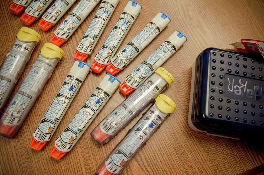 FILE -- EpiPens used for training school staff members in Ashburn, Va., Aug. 31, 2012. Mylan, the maker of the EpiPen, which will soon get a generic competitor, has started to raise the price of the device sharply, highlighting a common tactic in the drug industry: dramatically raising the cost in the years just before a generic version reaches the market, as a sort of final attempt to milk big profits from the brand-name drug. (Karen Kasmauski/The New York Times) ORG XMIT: XNYT172 Photo: KAREN KASMAUSKI / NYTNS