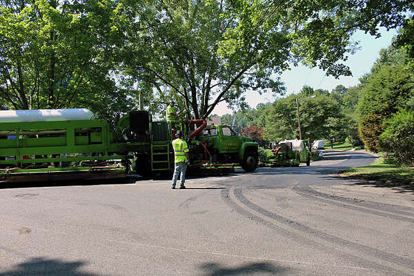 """The town is trying a """"hot in-place"""" method of paving that recycles the road's surface, filling cracks, holes and ruts. Fairfield, CT. 8/24/16"""