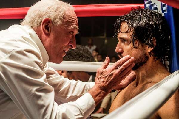 "This image released by The Weinstein Company shows Robert De Niro, left, and Edgar Ramirez in a scene from, ""Hands of Stone."" (Rico Torres/The Weinstein Company via AP)"