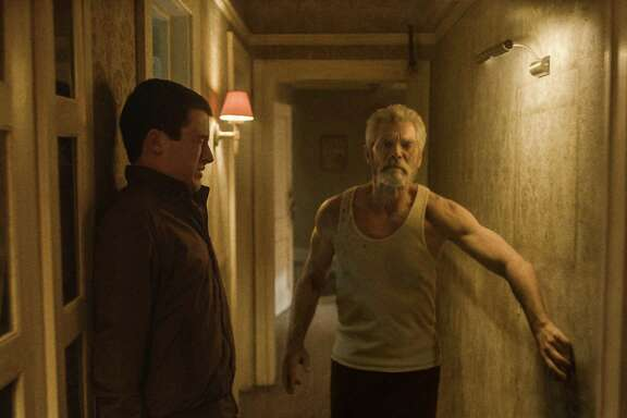 "This image released by Sony Pictures shows Dylan Minnette, left, and Stephen Lang in a scene from ""Dont Breathe."" (Sony/Screen Gems via AP)"