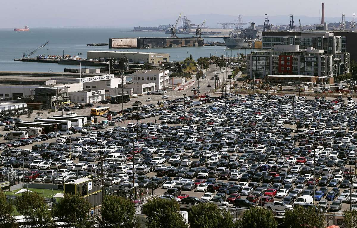 Looking out over Mission Bay from the upper deck of AT&T Park home of the San Francisco Giants on Wed. Aug. 17, 2016. The parking lot shown is part of a development project at risk from sea level rise - as is much of the Bay Area's shoreline - so planners want the height of the land raised by several feet before construction begins.