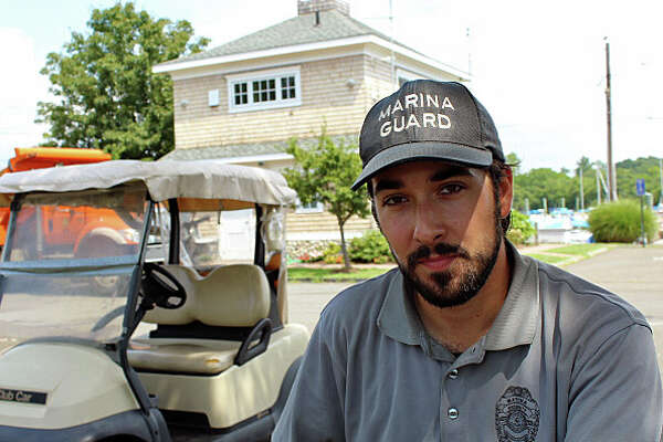 Jarrod Figueroa, 25, does double duty as both a marina guard and a school crossing guard. Fairfield, CT. 8/22/16