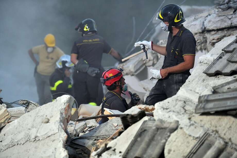 Emergency workers search the rubble after a quake in Amatrice, Italy. Photo: Carl Court, Getty Images