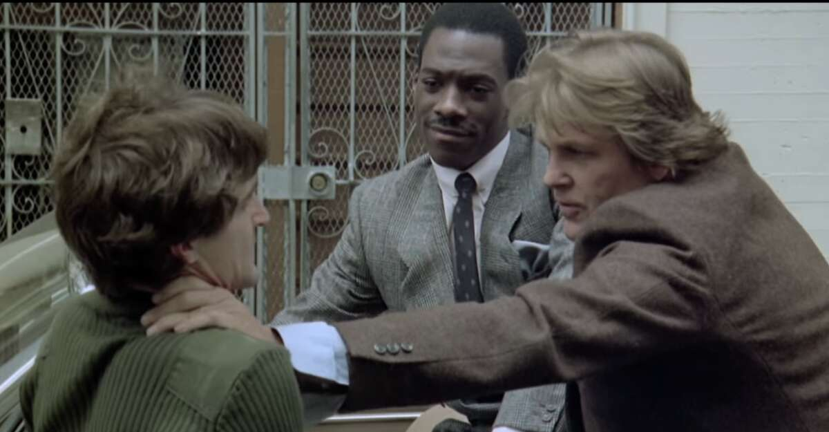 48 Hrs. (1982) The scene: Jack Cates (Nick Nolte) and Reggie Hammond (Eddie Murphy) catch criminal Luther (David Patrick Kelly) in an alley after Hammond opens the car door to trip him up.