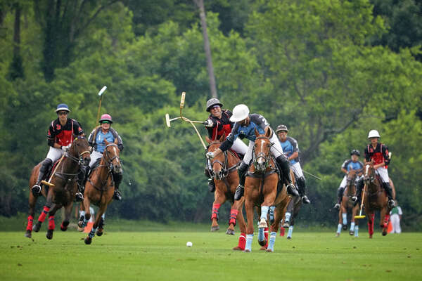 Postage Stamp Farm's Brandon Phillips and Goose Creek's Marcos Garcia del Rio hook mallets during a game at Greenwich Polo Club.