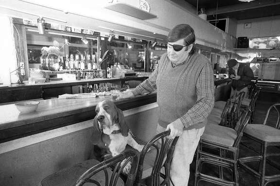 Warren Hinckle, and his Basset dog Bentley at the Pipeline bar  Photo taken October 5, 1984
