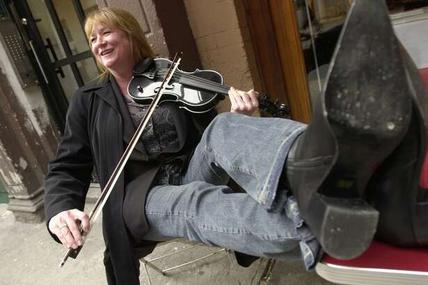 File photo of violinist Soozie Tyrell, who plays with the Bruce Springsteen band and made her her first solo album in 2003. A former Stratford town official has agreed to pay her $455,000 after an investment deal went sour.