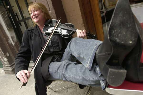 File photo of violinist Soozie Tyrell, who plays with the Bruce Springsteen band and made her her first solo album in 2003. A former Stratford town official has agreed to pay her $325,000 after an investment deal went sour.