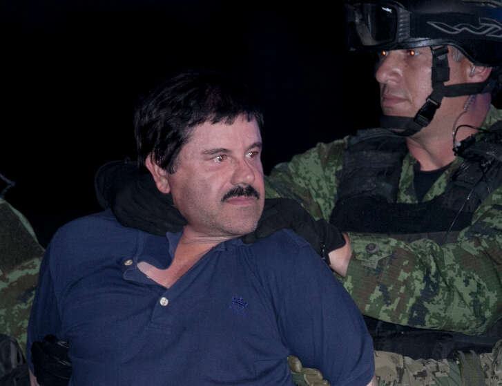 "FILE - In this Jan. 8, 2016 file photo, Joaquin ""El Chapo"" Guzman is made to face the press as he is escorted to a helicopter in handcuffs by Mexican soldiers and marines at a federal hangar in Mexico City, Mexico. Mexico?s Foreign Relations department has ruled that the extradition of Guzman to the United States can go forward. The department said Friday, May 20, 2016 that the U.S. had guaranteed that Guzman would not face the death penalty, which is not applied in Mexico. The process can be appealed. (AP Photo/Marco Ugarte, File)"