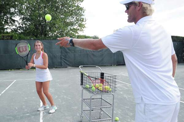 At left, Schuyler Sargent, 13, of Greenwich, works on her game with the help of Stanwich Club tennis instructor Chris Post during the Connecticut Alliance for Tennis and Education and the USTA Foundation youth tennis clinic that was part of the sixth annual Connecticut Pro-Am and Gala at the Stanwich Club in Greenwich, Conn., Thursday, Aug. 25, 2016. Tennis coaching legend Nick Bollettieri served as Honorary Chair for the event and coached during the youth clinic. Stanwich Club Director of Racquets Sebastian Bredberg who was supervising the youth clinic said a main focus of the event was to promote and demonstrate the positive impact tennis instruction has on young people especially underserved youth.