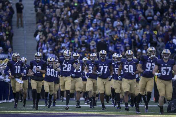 SEATTLE, WA - NOVEMBER 27: Members of the Washington Huskies take the field before a football game against the Washington State Cougars at Husky Stadium on November 27, 2015 in Seattle, Washington. The Huskies won the game 45-10. (Photo by Stephen Brashear/Getty Images)