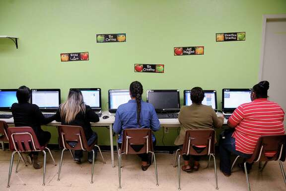 From left, Natalie McKensie, Ofelia Toledo, Yanci Vasquez, Xochitl Abalos and Marilene Bryant participate this week in a digital literacy training class at the Harbach-Ripley Neighborhood Center.