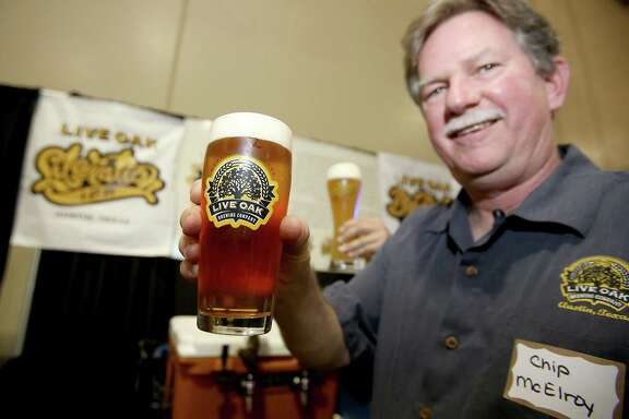 4/25/13: Live Oak owner and Brewmaster Chip McElroy displays a freshly poured draft at the retailer trade show at the Faust Distributing Center in Houston, Texas.