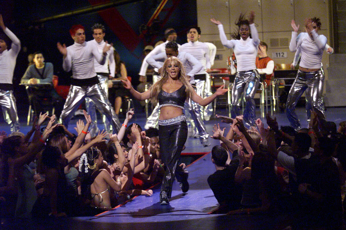 1999: Britney was still proud to show off her midriff.
