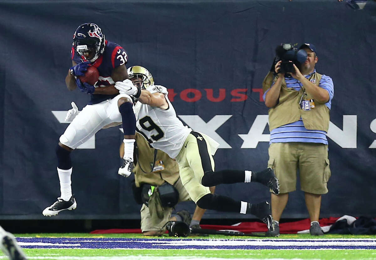 Cornerback Robert Nelson, left, preserves the Texans' 16-9 victory over the Saints on Saturday with an interception at the goal line on the last play of the game for one of the team's five takeaways in two preseason victories.