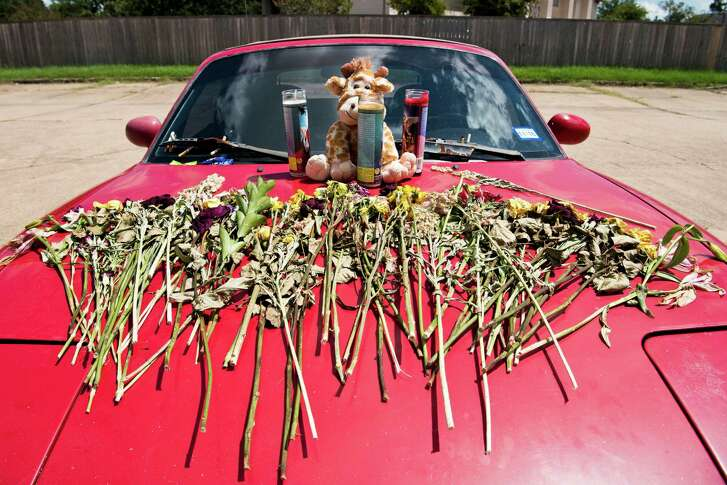 A car memorial stands Wednesday in front of the Sigma Nu fraternity house where authorities say a Texas A&M student died of an overdose Saturday.
