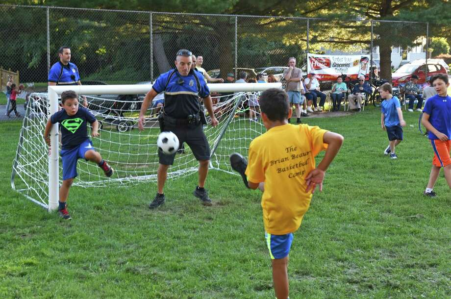 Police Sgt. Eric Crist plays goalie for a childrens soccer match as the Albany Police held a pop-up BBQ with community members at Sunset (Lounello) Park on Wednesday Aug. 24, 2016 in Albany, N.Y. (Michael P. Farrell/Times Union) Photo: Michael P. Farrell / 20037791A