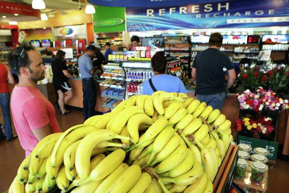 A display of bananas and other fruit is one of the first displays seen at the Valero Corner Store at the corner of I-10 and UTSA Blvd, on Friday, August 28, 2015.
