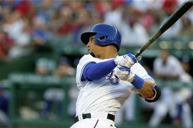 Texas Rangers' Carlos Gomez swings through hitting a three run homer during the second inning of a baseball game against the Cleveland Indians in Arlington, Texas, Thursday, Aug. 25, 2016. (AP Photo/LM Otero)
