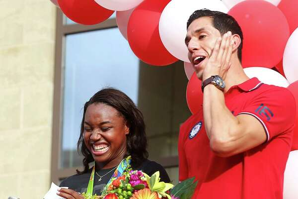 Simone Manuel, left, and Steven Lopez laugh as Manuel pulls out a prepared speech, during a welcome-home celebration at Sugar Land Town Square, Thursday, Aug. 25, 2016, in Sugar Land. Manuel won two gold medals in Rio de Janeiro, and Lopez is a five-time olympian, who has two career gold medals.