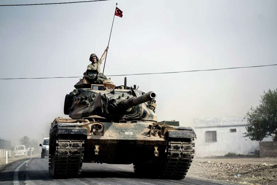 Turkish tanks and armored personnel carriers move toward the Syrian border Thursday. Turkey's moves are aimed at Syrian Kurdish forces and ISIS. Photo: Halit Onur Sandal, STR / Copyright 2016 The Associated Press. All rights reserved. This material may not be published, broadcast, rewritten or redistribu