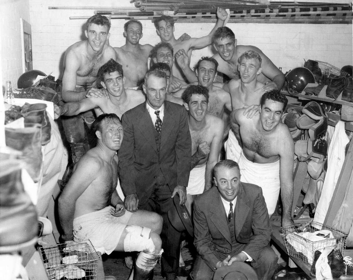 11/26/1949 - Surrounding their coach Jess Neely, the Rice Owls celebrate in the locker room after clinching the Southwest Conference title with a win against the Baylor Bears, 21-7.
