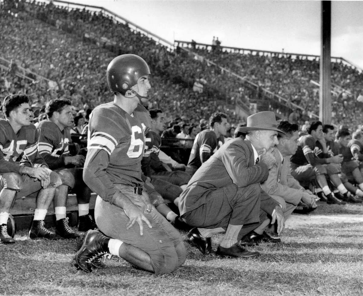 1957 - Rice University football coach Jess Neely watches the game intently from the sideline at old Rice Stadium.