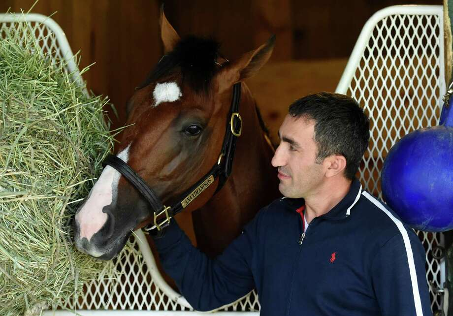 Trainer Mikhail Yanakov spends some quite time with Travers Stakes contender Anaximandros outside his stall on the main track Thursday August 25, 2016 at the Saratoga Race Course in Saratoga Springs, N.Y.    (Skip Dickstein/Times Union) Photo: SKIP DICKSTEIN