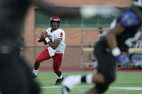 North Shore's quarterback Bryant Badie (9) looks to pass during the  first half of varsity football action against Dekaney on Thursday, Aug. 25, 2016, in Spring.