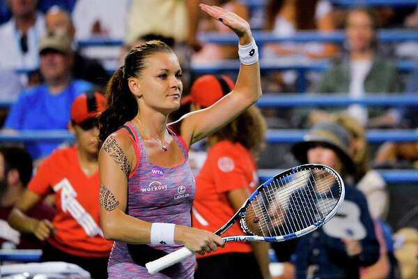 NEW HAVEN, CT - AUGUST 25:  Agnieszka Radwanska of Poland celebrates after defeating Kirsten Flipkens of Belgium on day 5 of the Connecticut Open at the Connecticut Tennis Center at Yale on August 25, 2016 in New Haven, Connecticut.  (Photo by Alex Goodlett/Getty Images)