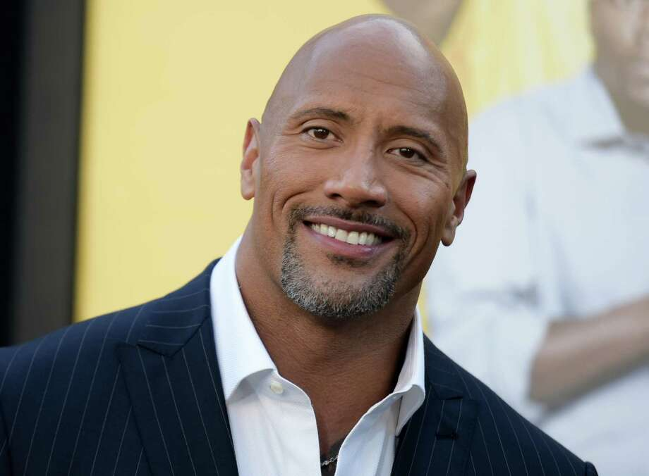 """FILE - In this June 10, 2016 file photo, Dwayne Johnson attends the premiere of his film, """"Central Intelligence""""  in Los Angeles.  Johnson is the highest-paid actor with a fast and furious income of $64.5 million, according to Forbes magazine. Johnson, the former wrestler whose income swelled thanks to the films """"Central Intelligence"""" and """"Fast 8,"""" beat out Jackie Chan with $61 million and Matt Damon, who earned $55 million. (Photo by Richard Shotwell/Invision/AP, File) ORG XMIT: NYET401 Photo: Richard Shotwell / Invision"""