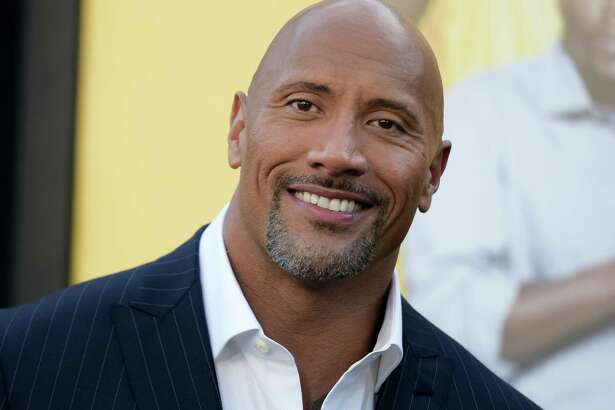 """FILE - In this June 10, 2016 file photo, Dwayne Johnson attends the premiere of his film, """"Central Intelligence""""  in Los Angeles.  Johnson is the highest-paid actor with a fast and furious income of $64.5 million, according to Forbes magazine. Johnson, the former wrestler whose income swelled thanks to the films """"Central Intelligence"""" and """"Fast 8,"""" beat out Jackie Chan with $61 million and Matt Damon, who earned $55 million. (Photo by Richard Shotwell/Invision/AP, File) ORG XMIT: NYET401"""