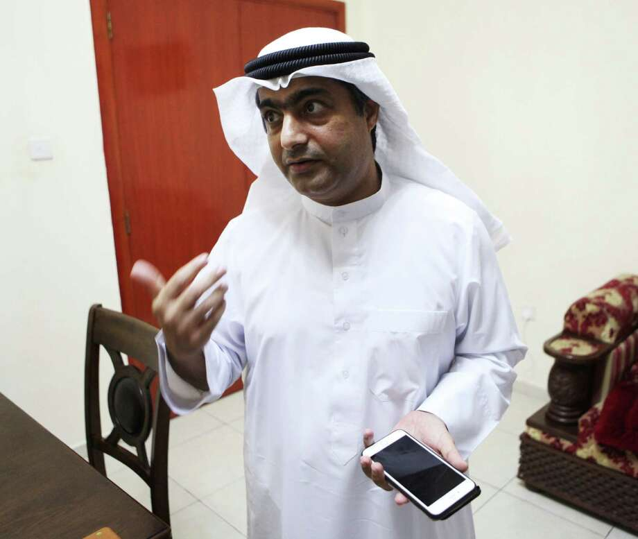 Human rights activist Ahmed Mansoor speaks to Associated Press journalists in Ajman, United Arab Emirates, on Thursday, Aug. 25, 2016. Mansoor was recently targeted by spyware that can hack into Apple's iPhone handset. The company said Thursday it has updated its security. (AP Photo/Jon Gambrell) ORG XMIT: WPJG103 Photo: Jon Gambrell / Copyright 2016 The Associated Press. All rights reserved. This m