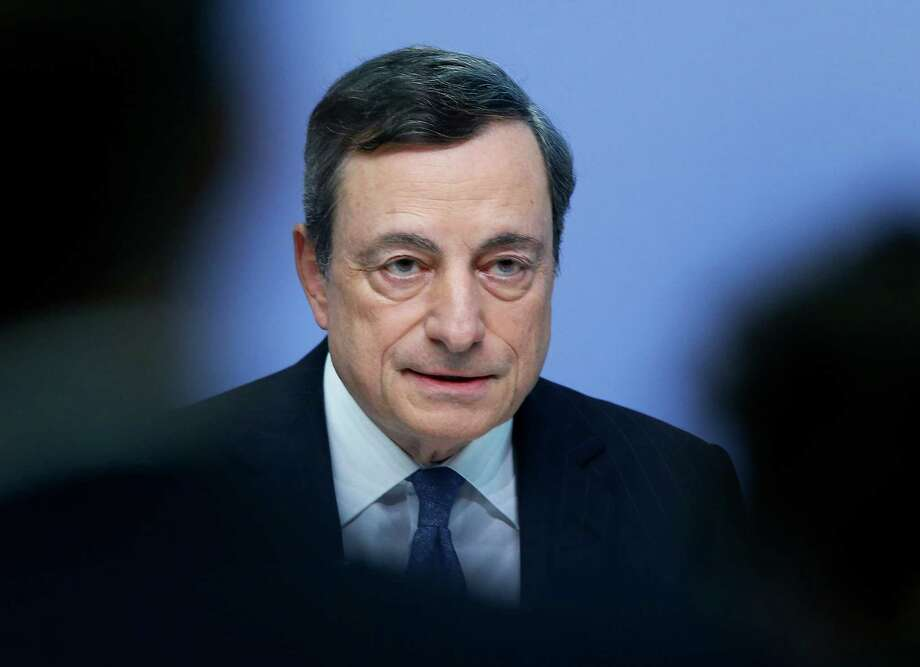 FILE - In this Thursday, July 21, 2016, file photo, European Central Bank President Mario Draghi speaks during a news conference in Frankfurt, Germany, after a meeting of the governing council. The Federal Reserve, the European Central Bank and the Bank of Japan have pumped trillions of dollars into global financial markets and taken the radical step of pushing interest rates below zero in Europe and Japan. But the results have been lackluster. (AP Photo/Michael Probst, File) ORG XMIT: NYBZ403 Photo: Michael Probst / Copyright 2016 The Associated Press. All rights reserved. This m