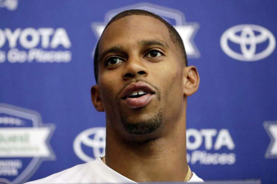 FILE - In this July 29, 2016, file photo, New York Giants wide receiver Victor Cruz talks to reporters during NFL football training camp in East Rutherford, N.J. The oft-injured  Cruz isn't giving up on his hope to play for the Giants. The 29-year-old wide receiver remained optimistic Wednesday, Aug. 17, 2016, despite being sidelined the past few days by a groin injury. (AP Photo/Julio Cortez, File) ORG XMIT: NY173 Photo: Julio Cortez / AP