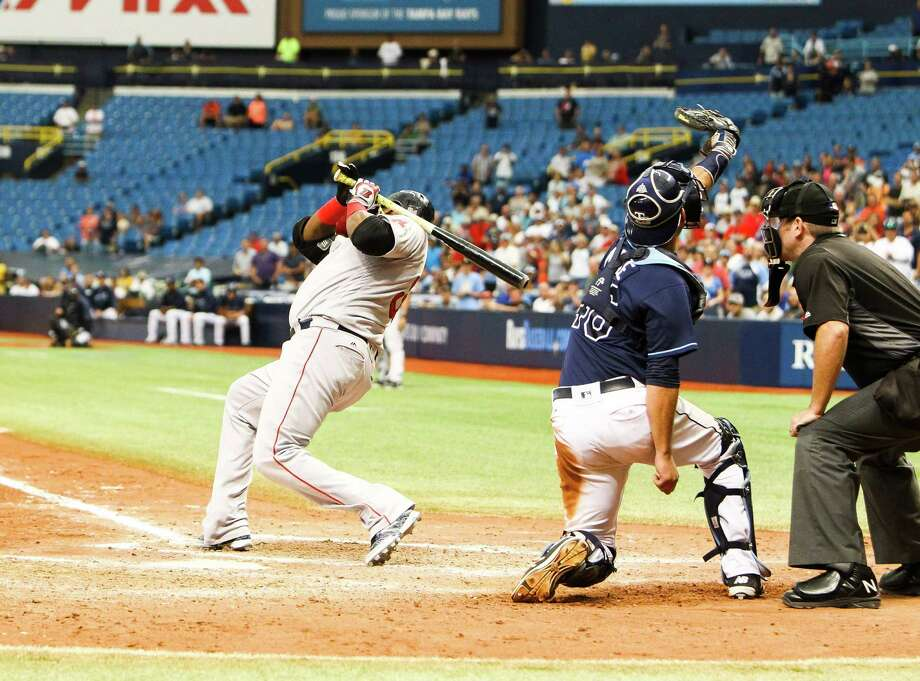 Boston Red Sox designated hitter David Ortiz (34) dives back from a pitch from Tampa Bay Rays relief pitcher Enny Romero (45) in the ninth inning of a baseball game, Thursday, Aug. 25, 2016 in St. Petersburg, Fla. (Will Vragovic/Tampa Bay Times via AP) ORG XMIT: FLPET107 Photo: Will Vragovic / Tampa Bay Times