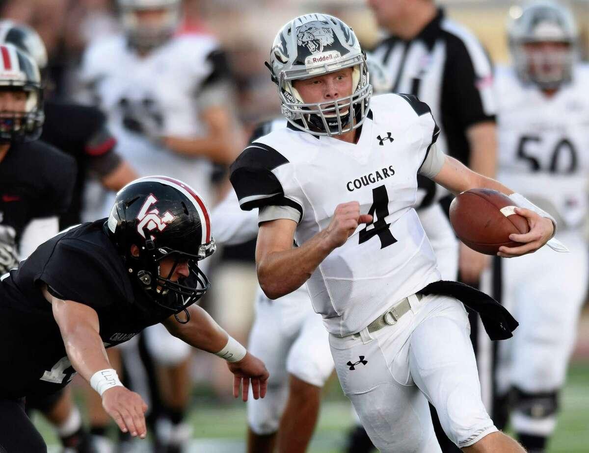 Clark senior quarterback Jake Stewart runs against the Churchill defense during high school football action at Comalander Stadium on Thursday, Aug. 25, 2106.