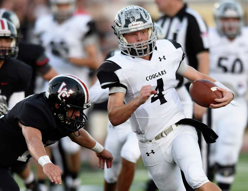 Clark senior quarterback Jake Stewart runs against the Churchill defense during high school football action at Comalander Stadium on Thursday, Aug. 25, 2106.