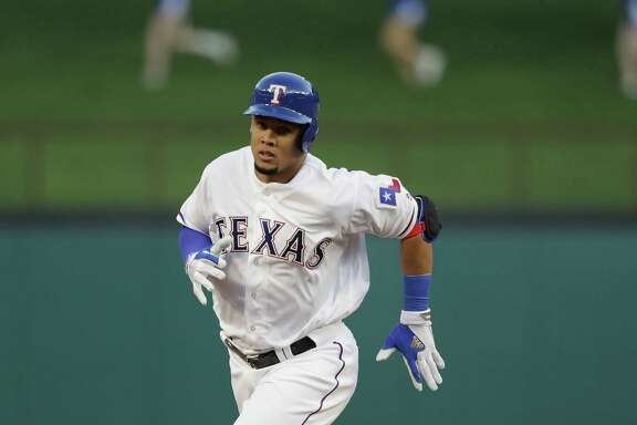 Carlos Gomez, recently let go by the Astros, trots around the bases after homering in his first at-bat with the Rangers, whom he joined Thursday night.