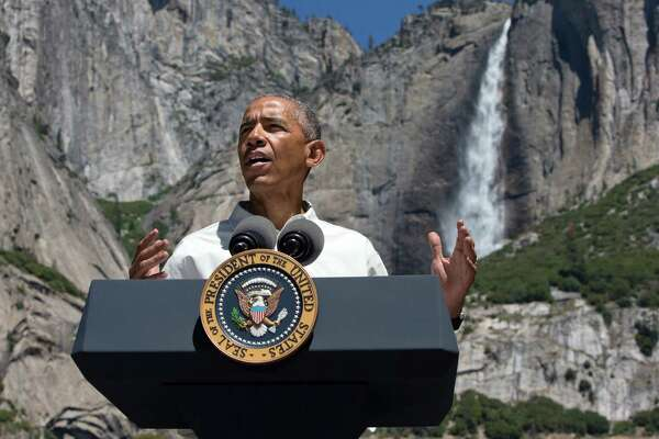 FILE - In this Saturday, June 18, 2016, file photo, President Barack Obama speaks by the Sentinel Bridge in the Yosemite Valley, in front of Yosemite Falls, the highest waterfall in the park, at Yosemite National Park, Calif. In a new project with National Geographic, Obama becomes the first sitting U.S. president to project himself into virtual reality, in this case, a 360-degree representation of Yosemite National Park. The 11-minute VR video, narrated by Obama, is one part paean to the wonders of America's national parks and one part warning of the threat posed by climate change. (AP Photo/Jacquelyn Martin, File)