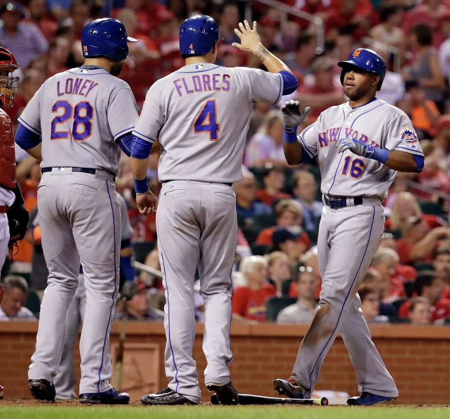 New York Mets' Alejandro De Aza, right, is congratulated by teammates James Loney (28) and Wilmer Flores (4) after hitting a three-run home run during the fifth inning of a baseball game against the St. Louis Cardinals Thursday, Aug. 25, 2016, in St. Louis. (AP Photo/Jeff Roberson) ORG XMIT: MOJR113 Photo: Jeff Roberson / Copyright 2016 The Associated Press. All rights reserved. This m