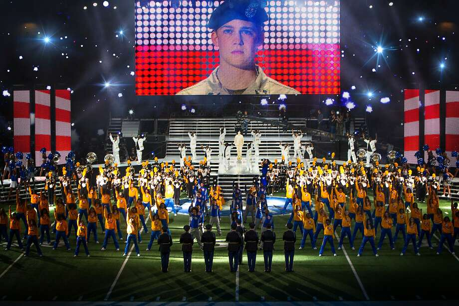 """This image released by Sony Pictures shows Joe Alwyn, portraying Billy Lynn, on a screen in a scene from the film, """"Billy Lynn�s Long Halftime Walk."""" The film, by Ang Lee, will premiere at the New York Film Festival on Oct. 14. (Mary Cybulski/Sony-TriStar Pictures via AP) Photo: Mary Cybulski, Associated Press"""