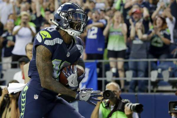 Seattle Seahawks wide receiver Paul Richardson celebrates after scoring a touchdown against the Dallas Cowboys in the first half of a preseason NFL football game, Thursday, Aug. 25, 2016, in Seattle. (AP Photo/Elaine Thompson)