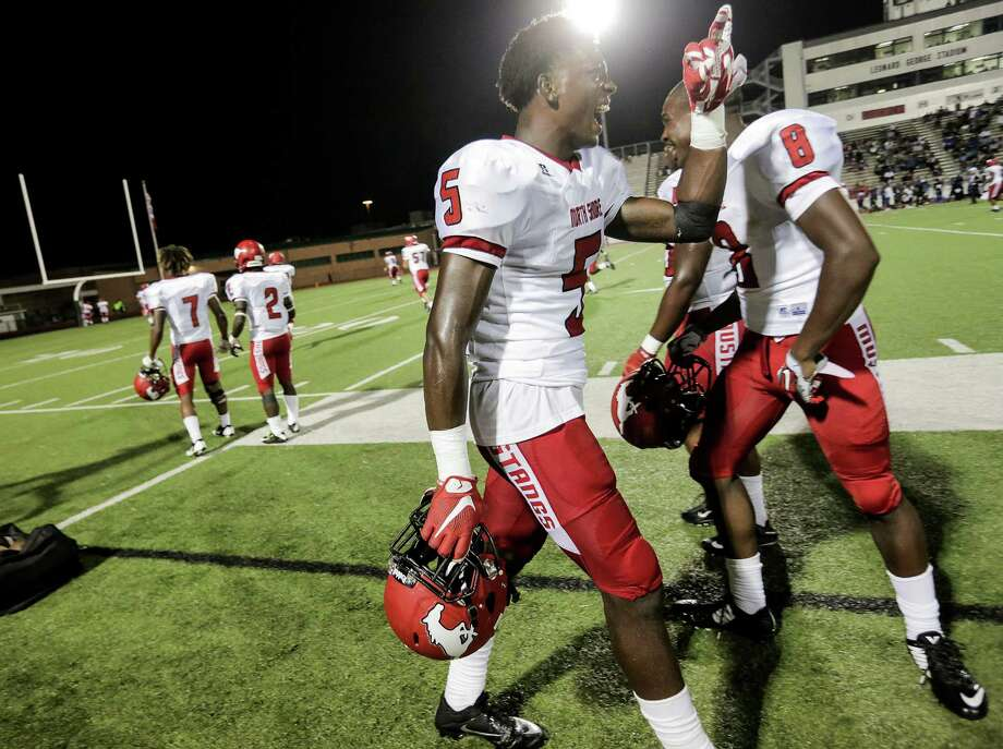 North Shore football players including Patrick Davis (5) and Chance Pillar (8) celebrate the team's touchdown in the fourth quarter, putting them ahead 50-19 over Dekaney. Photos of varsity football action between North Shore and Dekaney high schools on  Thursday, Aug. 25, 2016, in Spring. North Shore won the game 56-19. Photo: Elizabeth Conley, Houston Chronicle / © 2016 Houston Chronicle