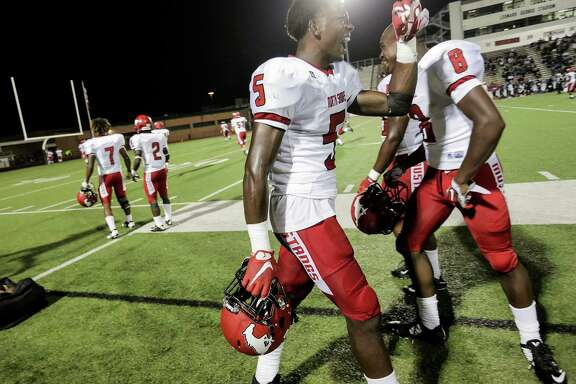 North Shore football players including Patrick Davis (5) and Chance Pillar (8) celebrate the team's touchdown in the fourth quarter, putting them ahead 50-19 over Dekaney. Photos of varsity football action between North Shore and Dekaney high schools on  Thursday, Aug. 25, 2016, in Spring. North Shore won the game 56-19.