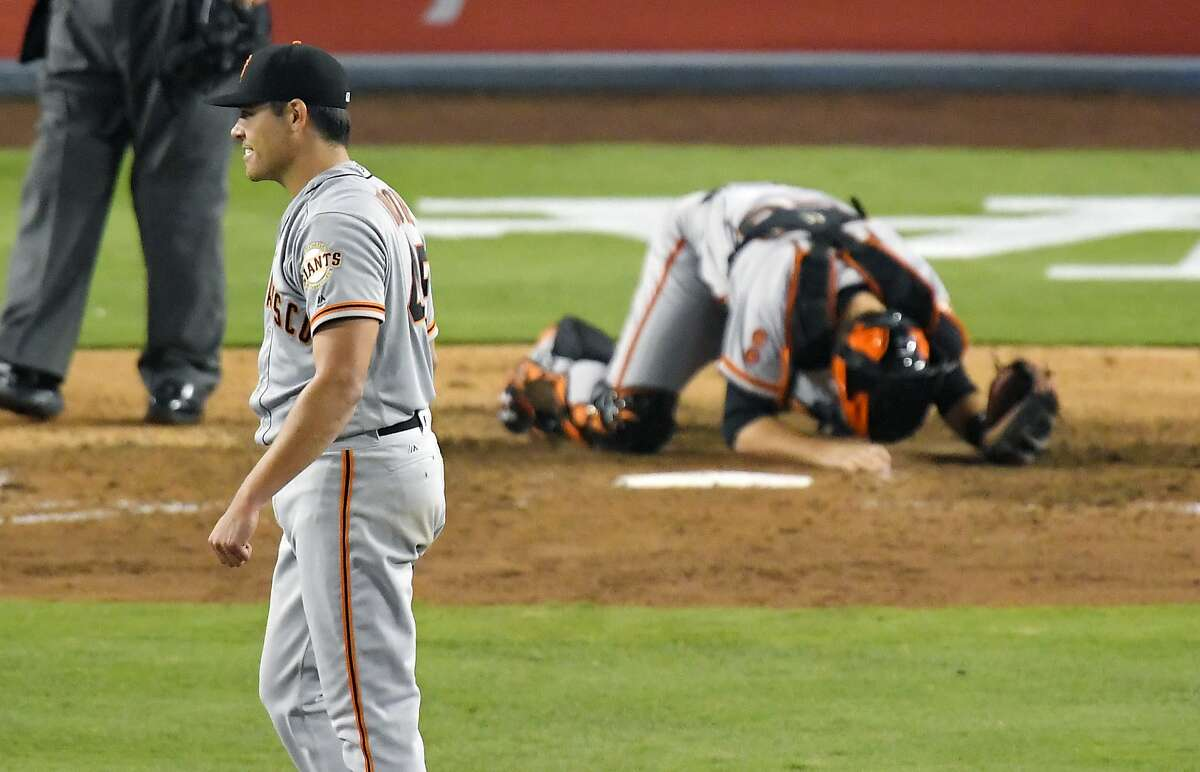 San Francisco Giants starting pitcher Matt Moore, left, and catcher Buster Posey react after Los Angeles Dodgers' Corey Seager hit a single with two outs in the during the ninth inning of a baseball game, Thursday, Aug. 25, 2016, in Los Angeles. Moore had a no-hitter going up until that point. The Giants won 4-0. (AP Photo/Mark J. Terrill)